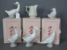 Nao - Three boxed figurines of ducks, two unboxed and a Portmeirion Parian jug.