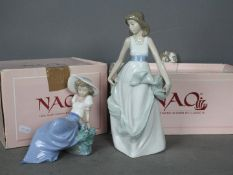Nao - Two boxed figurines comprising Listening To Bird Song #1042 and Playing With The Wind # 1343,