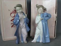 Nao - Two boxed Nao figurines to include My Daddy's Coat # 1316 and Just Like Dad #1319,