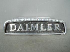 Automobilia - A cast aluminium Daimler bus badge, approximately 10.5 cm x 38 cm.
