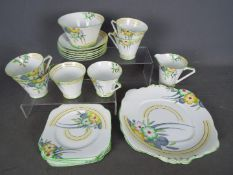 An Art Deco tea service by Bell China, of conical form,