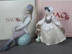 Nao - Two boxed figurines comprising Faithful Friend # 1650 and one of a Milk Maid # 0494,