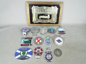Automobilia - A collection of various car badges and a Rolls Royce advertising mirror.