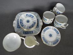 A Coalport Revelry tea service comprising six cups and saucers, six side plates, sugar bowl,