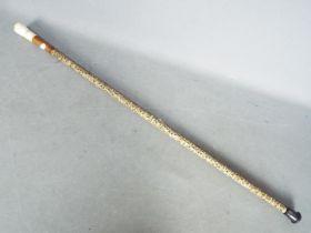 A shark vertebrae walking stick,