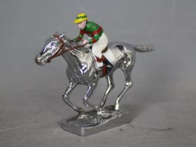 Automobilia - Louis Lejeune: a chrome car mascot in the form of a racehorse and jockey,
