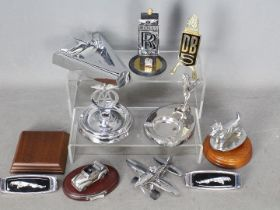 Automobilia - A collection of car badges,