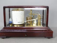 A mahogany cased, gilt brass barograph by F Darton & Co Ltd,