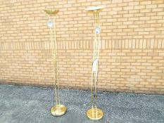 Two modern floor standing lamps, approximately 180 cm (h).