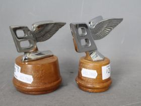 Automobilia - Two Bentley Flying B car mascots, mounted on wooden plinths,