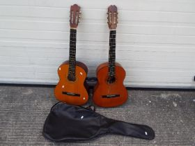 Two acoustic guitars comprising a Hohner MC05 and a Balmeria in soft case.