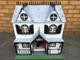 Three scratch built wooden dolls houses. Click on photographs to view each house.