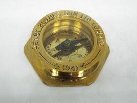 A boxed brass compass by Henry Hughes