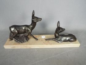A deer set on a marble plinth,