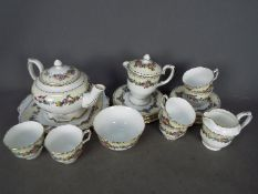 A Crown Staffordshire tea service with floral decoration comprising teapot, milk jug and sugar bowl,