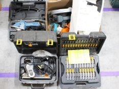 A collection of tools to include electric planer, circular saw, power drill,