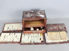 A vintage Mahjong set, wooden case with five drawers housing bone and bamboo tiles,