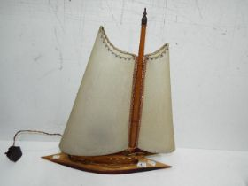 A vintage lamp in the form of a yacht, a