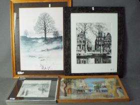 A collection of framed prints to include