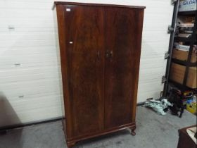 A good quality twin door wardrobe with f