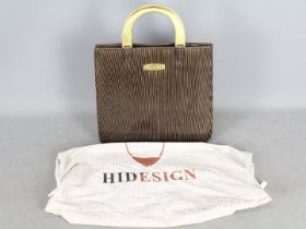 A vintage Mulberry handbag with gold ton