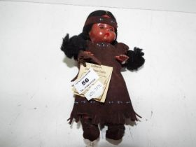 A clothed plastic doll with sleeping eye