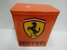 A orange storage tin marked Ferrari, app