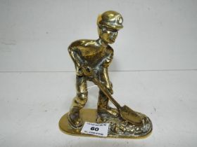 A brass figure in the form of a coal min