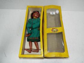 A boxed Pelham puppet
