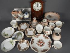 A collection of ceramics to include tea wares, Japanese also includes a wall clock.