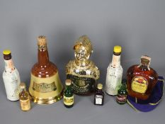 Lot to include a 500ml bottle of Crown Royal whisky 80 proof, 1974, a small quantity of miniatures,
