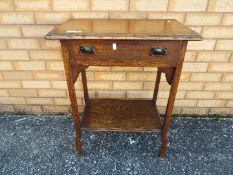 A small oak side table measuring approximately 75 cm x 61 cm x 37 cm