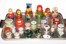 Sixteen enamel boxes including eight Halcyon Days, two Chinese frog boxes, and six Russian dolls.