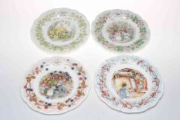 Seven Royal Doulton Brambly Hedge figures together with four seasonal hanging plates and four mugs.