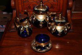 Gilded blue glass eleven piece tea set.