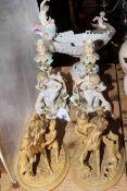 Pair Continental cherub candlesticks and maiden boat vase; pair equestrian figures,