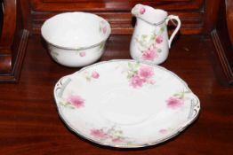 Royal Doulton twenty one piece tea set with pink flower decoration.