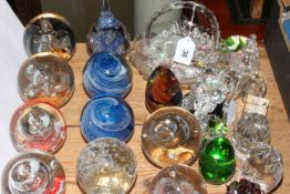 Collection of twenty six paperweights, pressed glass commemorative basket and crystal pieces.