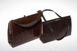 Two vintage skin handbags.