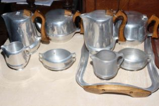 Nine pieces of Piquot teaware including two four-piece tea sets and single tray.