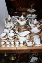 Royal Albert Country Roses including teapot, tureen, butter dish, approximately fifty pieces.