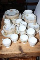 Coalport Wenlock fruit decorated part dinner and tea service, approximately eighty pieces.