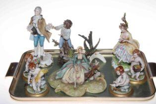 Three Capo di Monte figures and four cherubs, Continental figure and bird ornament (9).