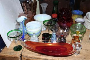 Collection of coloured glass and shades including perfume bottles, Saturn red glass bowl, Alum Bay.