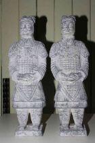 Pair of composite warrior statues, 58cm high.