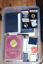 Large assortment of gold plated coins including Piedfort, cased commemorative medallions,