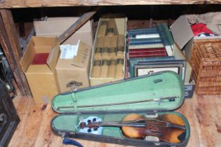 Collection of books, prints, violin in case, wicker picnic basket, fabrics, leather case, etc.