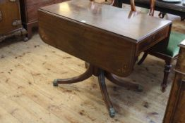 Regency inlaid mahogany Pembroke table having frieze drawer and raised on ring turned pedestal to