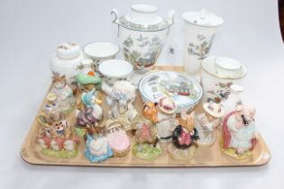 Twelve Beatrix Potter figures including Beswick, Wedgwood Chinese Legend and Kutani Crane vases,