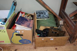 Two boxes of model train memorabilia including Triang boxed models, tracks, building accessories,